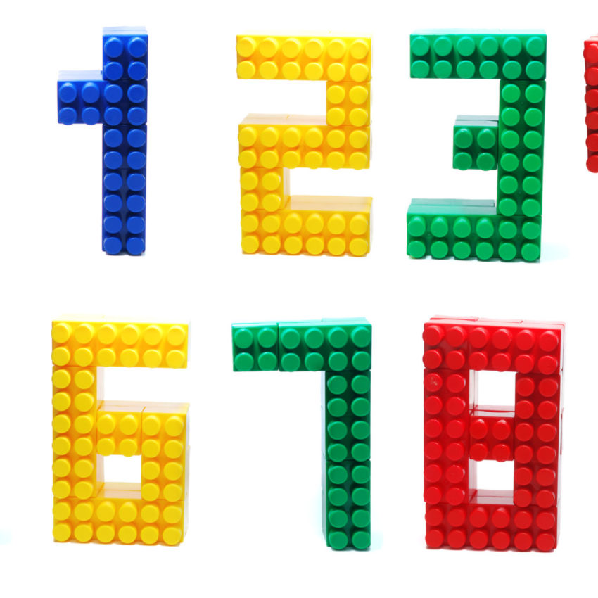 Colored Digits Set made of Plastic Toy Blocks (Lego) Isolated on White Background