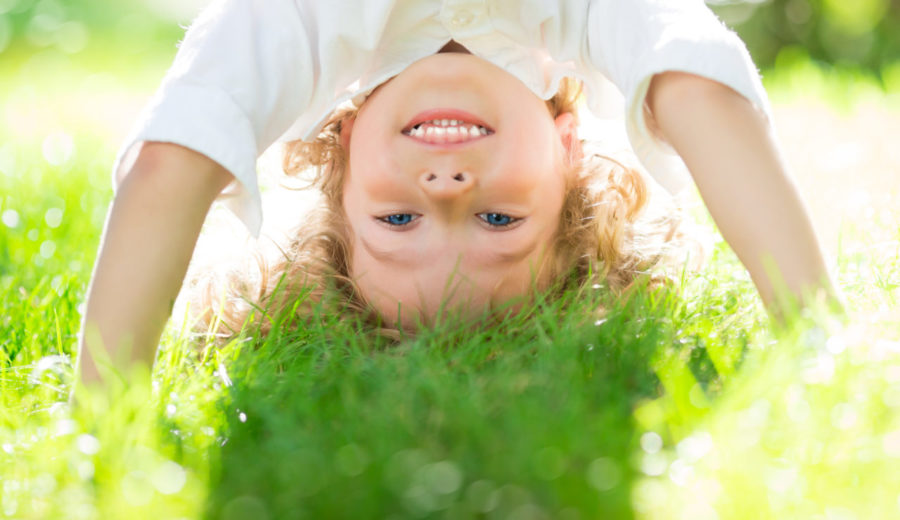 Child Doing Headstand - Why Summer Day Camps Are So Beneficial For Preschoolers