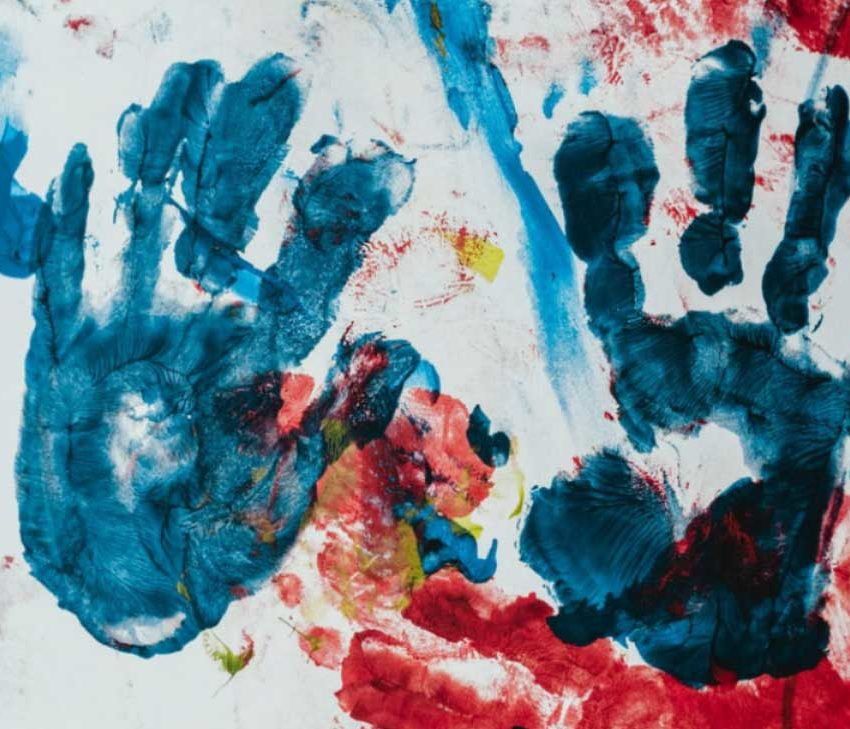 Preschooler hands painted on a wall