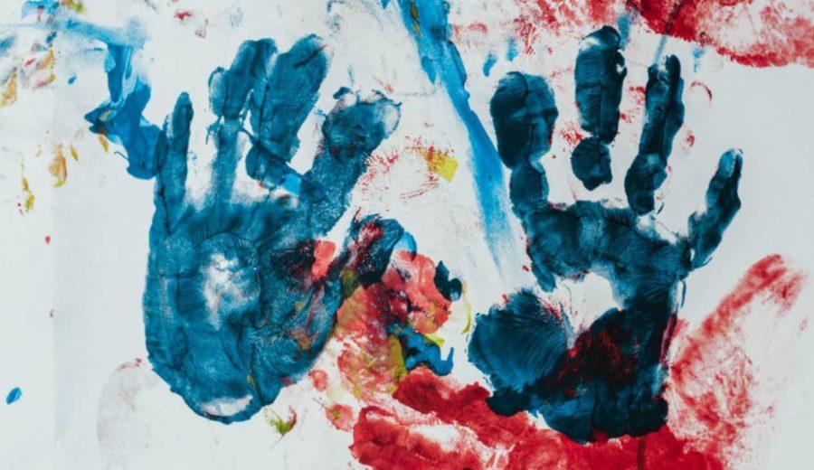 Preschooler hands painted on a wall